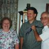 Sharon, Miller=Tawney, with Bruce Wells and Ed Bruder clowning around after singing for a friend at her 90th birthday.